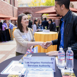 Student meeting an employer at a career event