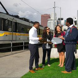Urban planning students near a train