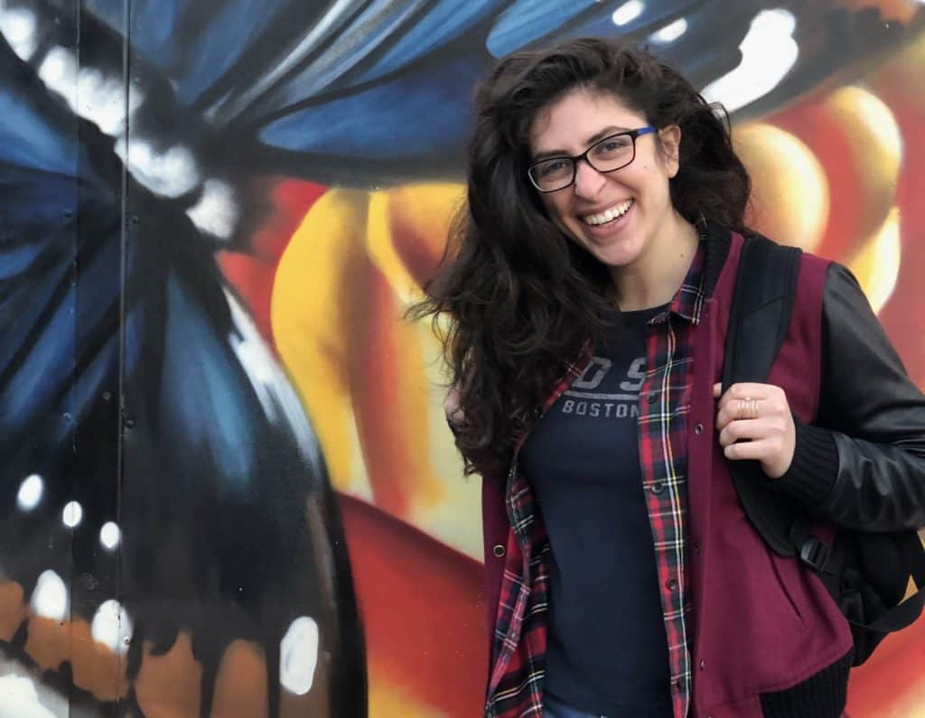 PhD candidate Marisa Turesky in front of painted wall
